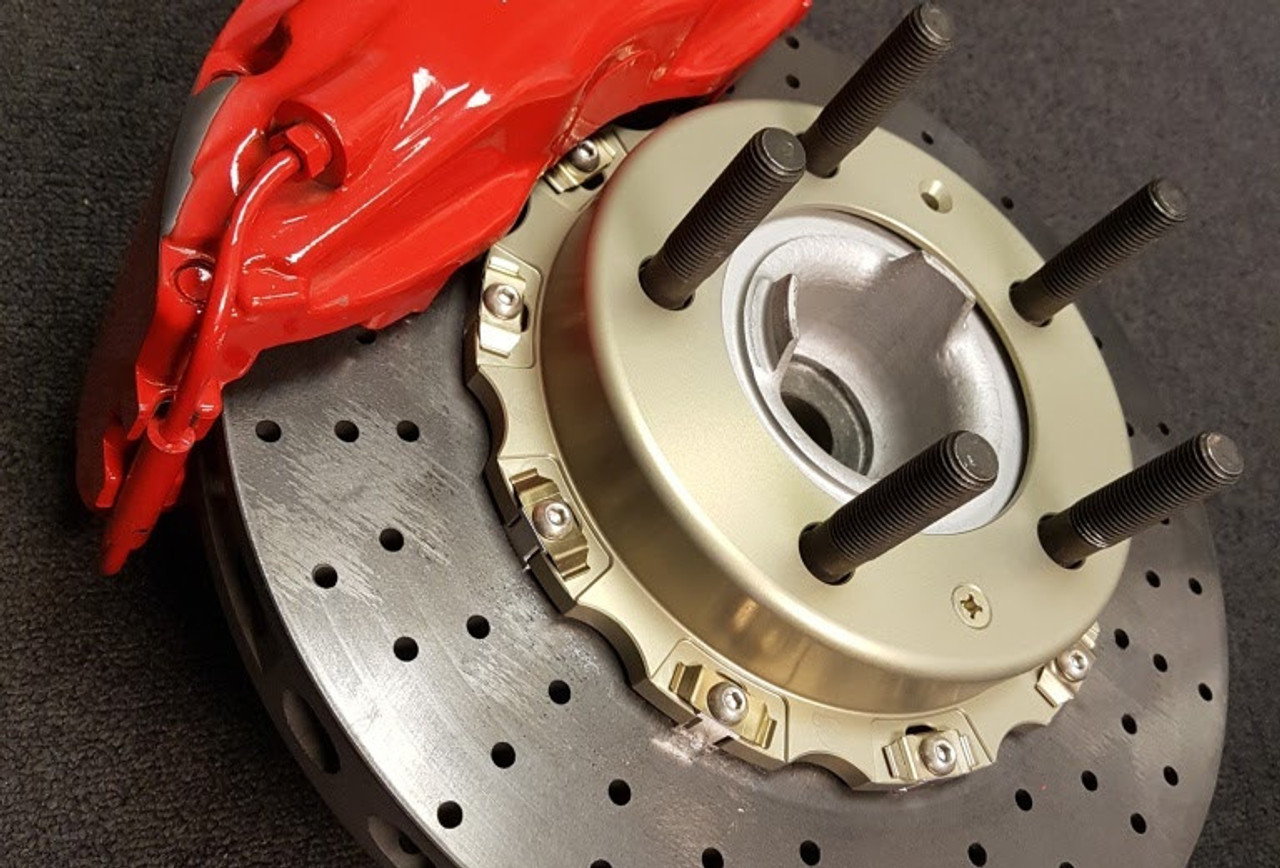 """CCST Carbon Ceramic  Brake Rotor Kit - 991 GT3/RS - Red Caliper -  with Track Pads:  STK.10.244.256- Kit Consists of:  - CCST Fully Assembled 2-Piece Rotor/Discs:  410mm x 36mm (F) x 2 + 400mm x 32mm (R) x 2  - Mouning Kit:Brake lines for larger diameter disc (OE Porsche parts)  - Brake Pad Set Front and Rear  - Includes Free Shipping in Continental / USA. In stock kits usually ship same day or within 48 hours.     RSS is proud to bring you the latest in Carbon Ceramic Brake Rotor Technology. CCST (Carbon Ceramic Surface Transform) Carbon Brake Discs are direct upgrade/replacement for Porsche PCCB and Porsche Steel Disc Brake Rotors.  CCST Carbon Ceramic Discs feature next generation """"Continuous Fiber Construction"""" - Patented Processvs Traditional Chopped Fiber Construction. Manufactured in the United Kingdom at ISO/TS16494 certified facilities and are strictly controlled to the highest standards.  CCST Discs are the choice of OEM Partners and Super Car / Hyper Car Manufactures such as: Aston Martin, Mono, Koenigsegg, Singer Vehicle Design in addition to several other OEM's who prefer anonymity. CCST rotors provide the ultimate in braking technology for motorsport such as the European Ferrari 458 Challenge, road-going hyper-cars and super-cars.  CCST Kits - Now Available for Porsche  •Porsche 981 Cayman GT4  •Porsche 991 GT3  •Porsche 991 GT3 RS  •Porsche 991 Turbo  •Porsche 991 Turbo S  •Porsche 991 Turbo  •Porsche 997 GT2  •Porsche 997 GT3  •Porsche 997 GT3 RS  •Porsche 997 Turbo  (993 Turbo Coming Soon!)  CCST - Carbon Ceramic Rotors vs. OEM – PCCB Carbon Ceramic Brakes & Current Generation Ceramic Rotors  PERFORMANCE + VALUE:  - Temperature Reductions of up to 150 Degrees Celsius/302 Degrees Fahrenheit  - Up to 3x thermal conductivity of current generation Carbon-Ceramic Matrix Discs (CCM)  - Weight Savings of up to 70% over Iron brakes  - 10x lifespan improvement vs current generation CCM Discs  - Better Vehicle Dynamics, improved handling and drivability  - Re"""
