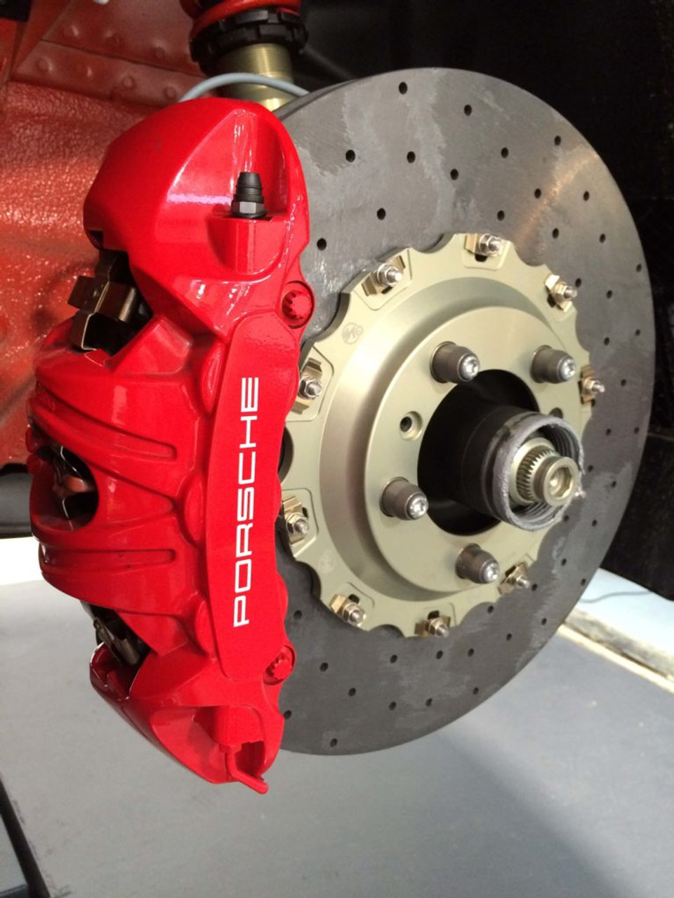 """CCST Carbon Ceramic  Brake Rotor Kit - 991 GT3/RS - Red Caliper -  with Track Pads:  STK.10.243.255 - Kit Consists of:  - CCST Fully Assembled 2-Piece Rotor/Discs:  410mm x 36mm (F) x 2 + 400mm x 32mm (R) x 2  - Mouning Kit:Brake lines for larger diameter disc (OE Porsche parts)  - Brake Pad Set Front and Rear  - Includes Free Shipping in Continental / USA. In stock kits usually ship same day or within 48 hours.     RSS is proud to bring you the latest in Carbon Ceramic Brake Rotor Technology. CCST (Carbon Ceramic Surface Transform) Carbon Brake Discs are direct upgrade/replacement for Porsche PCCB and Porsche Steel Disc Brake Rotors.  CCST Carbon Ceramic Discs feature next generation """"Continuous Fiber Construction"""" - Patented Processvs Traditional Chopped Fiber Construction. Manufactured in the United Kingdom at ISO/TS16494 certified facilities and are strictly controlled to the highest standards.  CCST Discs are the choice of OEM Partners and Super Car / Hyper Car Manufactures such as: Aston Martin, Mono, Koenigsegg, Singer Vehicle Design in addition to several other OEM's who prefer anonymity. CCST rotors provide the ultimate in braking technology for motorsport such as the European Ferrari 458 Challenge, road-going hyper-cars and super-cars.  CCST Kits - Now Available for Porsche  •Porsche 981 Cayman GT4  •Porsche 991 GT3  •Porsche 991 GT3 RS  •Porsche 991 Turbo  •Porsche 991 Turbo S  •Porsche 991 Turbo  •Porsche 997 GT2  •Porsche 997 GT3  •Porsche 997 GT3 RS  •Porsche 997 Turbo  (993 Turbo Coming Soon!)  CCST - Carbon Ceramic Rotors vs. OEM – PCCB Carbon Ceramic Brakes & Current Generation Ceramic Rotors  PERFORMANCE + VALUE:  - Temperature Reductions of up to 150 Degrees Celsius/302 Degrees Fahrenheit  - Up to 3x thermal conductivity of current generation Carbon-Ceramic Matrix Discs (CCM)  - Weight Savings of up to 70% over Iron brakes  - 10x lifespan improvement vs current generation CCM Discs  - Better Vehicle Dynamics, improved handling and drivability  - R"""