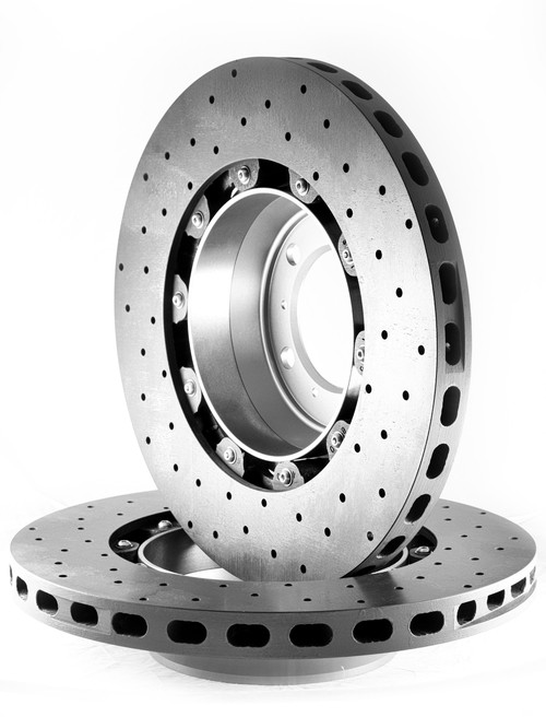 """RSS is proud to bring you the latest in Carbon Ceramic Brake Rotor Technology. CCST (Carbon Ceramic Surface Transform) Carbon Brake Discs are direct upgrade/replacement for Porsche PCCB and Porsche Steel Disc Brake Rotors.  CCST Carbon Ceramic Discs feature next generation """"Continuous Fiber Construction"""" - Patented Processvs Traditional Chopped Fiber Construction. Manufactured in the United Kingdom at ISO/TS16494 certified facilities and are strictly controlled to the highest standards.  CCST Discs are the choice of OEM Partners and Super Car / Hyper Car Manufactures such as: Aston Martin, Mono, Koenigsegg, Singer Vehicle Design in addition to several other OEM's who prefer anonymity. CCST rotors provide the ultimate in braking technology for motorsport such as the European Ferrari 458 Challenge, road-going hyper-cars and super-cars.  CCST Kits - Now Available for Porsche  •Porsche 981 Cayman GT4  •Porsche 991 GT3  •Porsche 991 GT3 RS  •Porsche 991 Turbo  •Porsche 991 Turbo S  •Porsche 991 Turbo  •Porsche 997 GT2  •Porsche 997 GT3  •Porsche 997 GT3 RS  •Porsche 997 Turbo  (993 Turbo Coming Soon!)  CCST - Carbon Ceramic Rotors vs. OEM – PCCB Carbon Ceramic Brakes & Current Generation Ceramic Rotors  PERFORMANCE + VALUE:  - Temperature Reductions of up to 150 Degrees Celsius/302 Degrees Fahrenheit  - Up to 3x thermal conductivity of current generation Carbon-Ceramic Matrix Discs (CCM)  - Weight Savings of up to 70% over Iron brakes  - 10x lifespan improvement vs current generation CCM Discs  - Better Vehicle Dynamics, improved handling and drivability  - Reduction in Noise, Vibration Harshness, vs. CCN or Steel Rotors  - Unrivaled Performance from Cold  - Refurbish CCST's up to 3 times, vastly reducing cost of ownership  REFURBISHMENT:  Unlike traditional chopped-fibre CCM discs, our next-generation continuous fibre construction of the CCST discs allow for refurbishing the discs up to three (3) times when traditional chopped-fibre CCM discs would need to be thrown awa"""