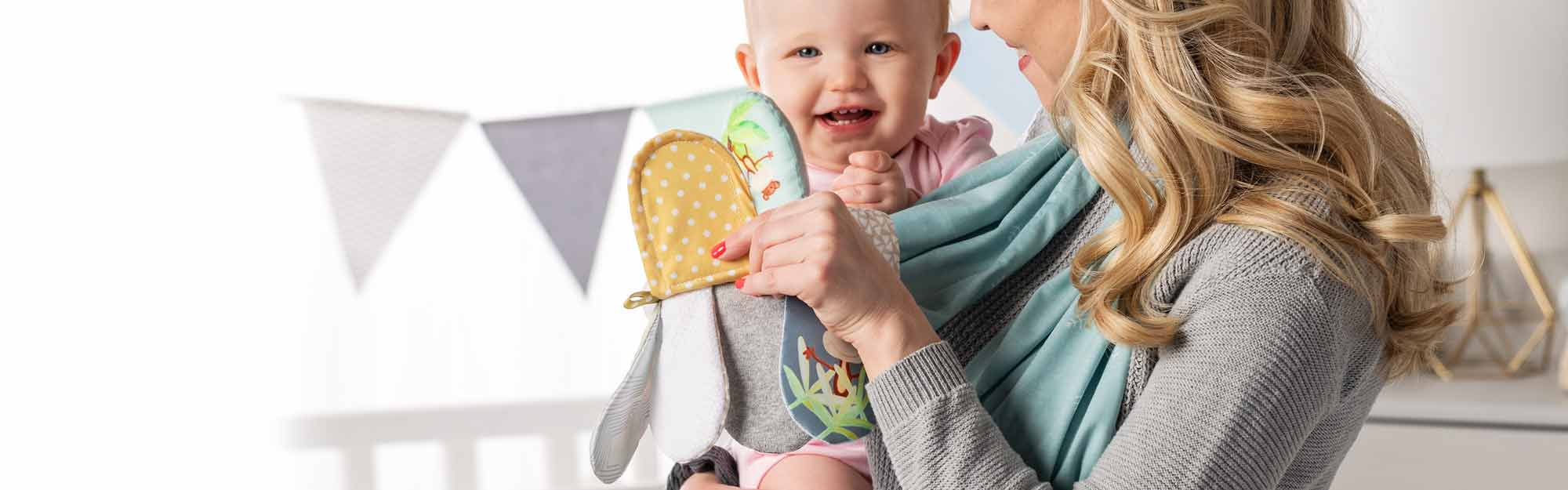 Mommy wearing a bright-colored scarf with texture activities for baby
