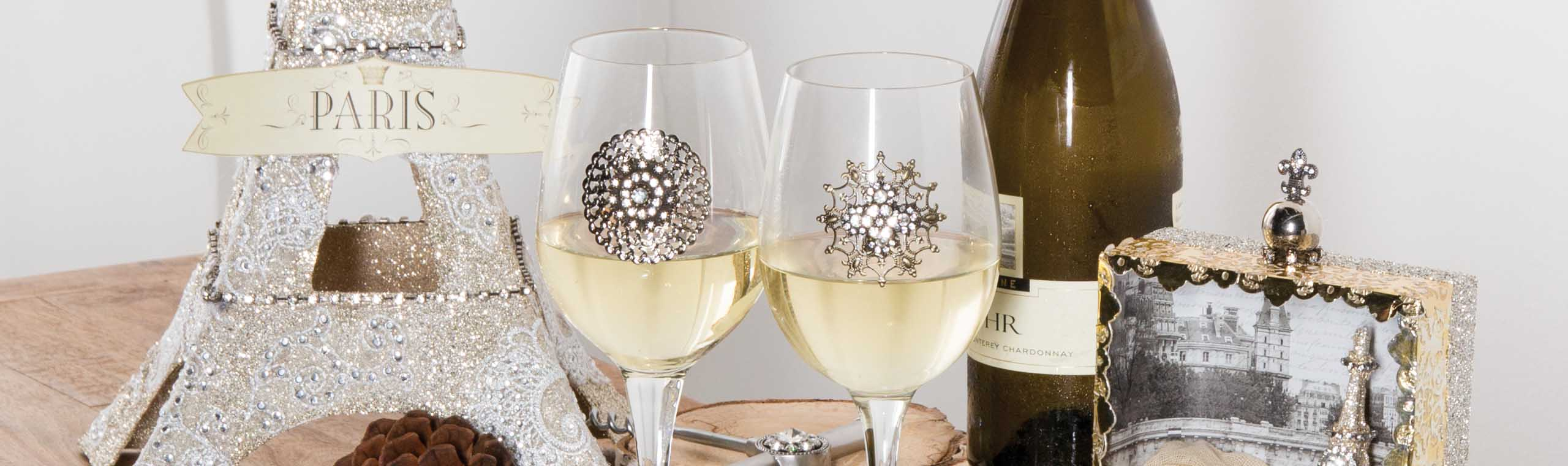 Gold, glitter and jewel embellished wine glasses and picture frames