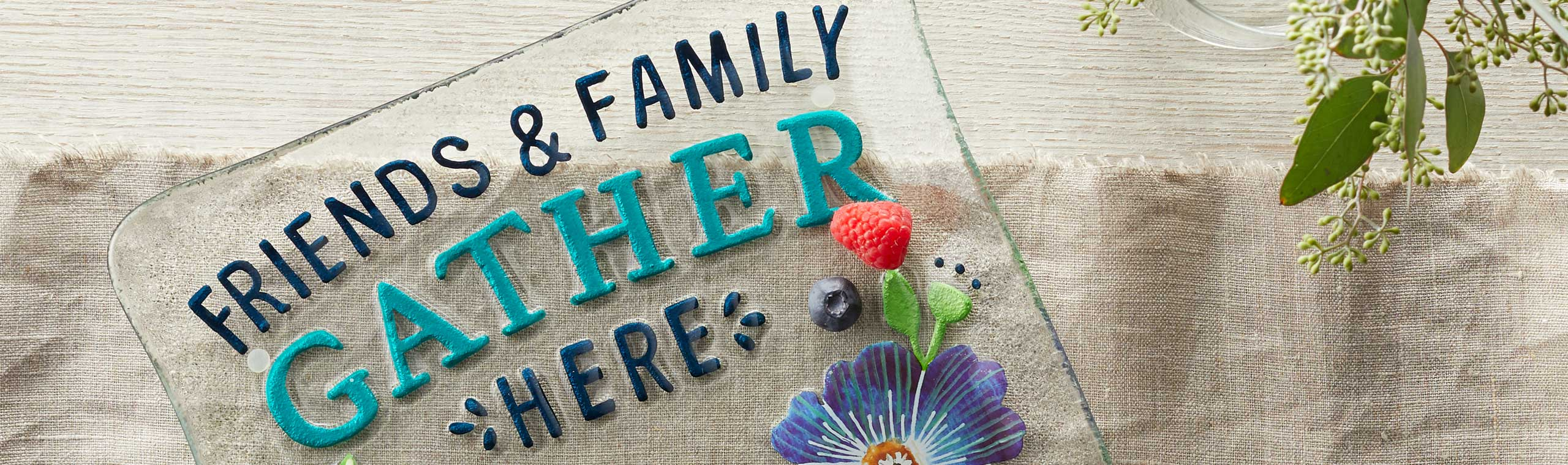 Colorful glass plate with the words Friends and Family Gather Together Here