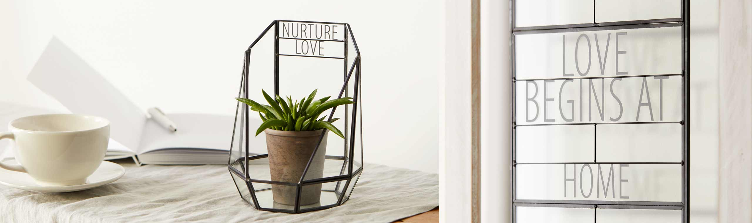 Glass and metal-edged terranium with the words Nurture Love and a frame with the words Love Begins at Home