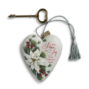 Light grey heart pendant with 'find peace and joy in the Christmas season' in red letters next to branches - gold key and light blue tassle attatched