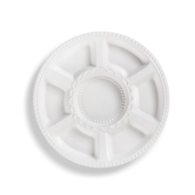 White round serving dish with round center and six rectangular dents