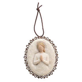 Close up of pendant - prayer angel figurine centered in white around a wooden outline