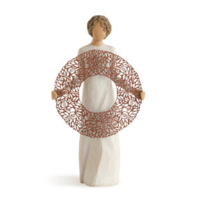Brunette woman figurine in white dress holding brown round figurine
