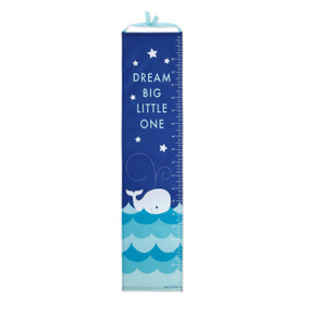 Dark blue height measuring chart with 'dream big little one' in light blue letters - bottom of it has white whale swimming on waves
