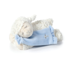 White stuffed lamb animal laying down with light blue blanket with silver cross printed on