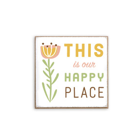 Square wall art with 'this is our happy place' in green/orange next to pink tulip flower