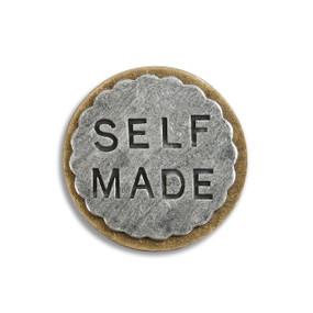 Small round silver 'self made' token