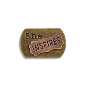 Small brown rectangle plaque with 'she inspires' carved in