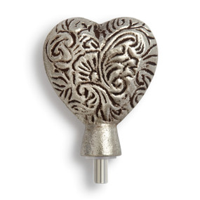 Close view of silver heart figurine topper