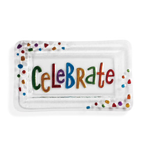 Clear glass platter with multi-colored text in center. Multi-colored confetti on top left and lower right corner of the rectangular platter.