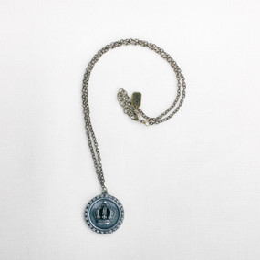 Silver charm necklace with light blue crown pendant