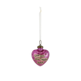 Small hanging pink heart pendant by white string that says 'love with your whole heart' in black