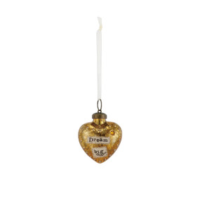 Small gold heart pendant hanging from white string with 'dream big' in black
