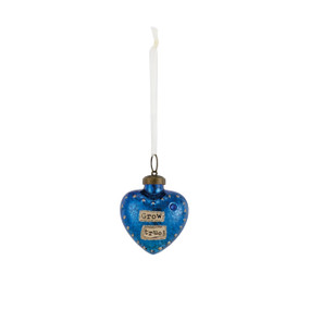 Hanging dark blue heart pendant from white string that says 'grow true' in tan banner