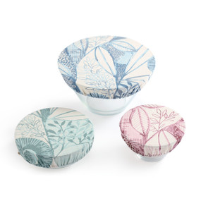 Three bowls laid out with covers on them - one is green flower print, one is blue flower print, one is pink flower print
