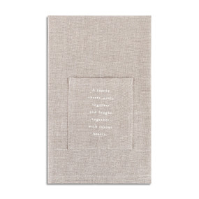 tan fabric napkin with quote about family printed on pocket for silverware