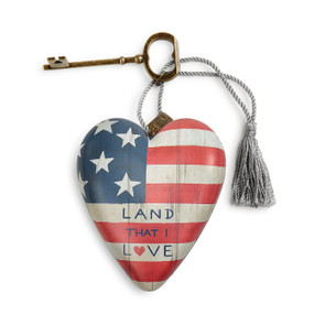 ceramic heart with American flag design reading Land That I Love tied to brass key