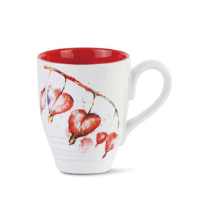 white mug painted red inside with painted leaves on a branch on outside