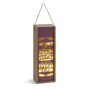 vertical wooden box with lights inside and Thankful and Grateful Today and Every Day etched into it
