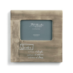 brown wooden picture frame with quote about sister written on front in white script font