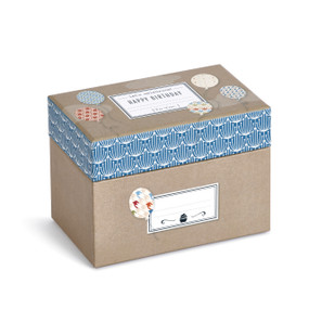 cardboard box with balloon stickers with Happy Birthday written on top