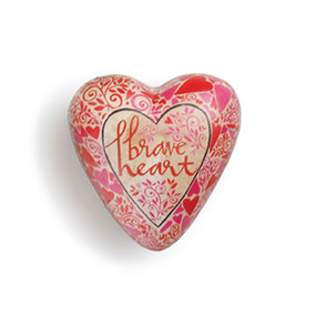 Small light pink/red heart with 'brave heart' carved in the center