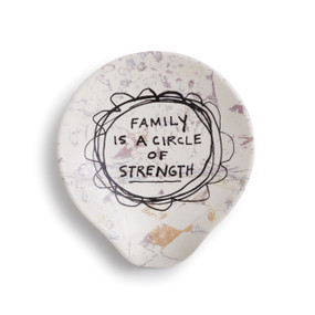 Cream spoon rest with light purple / orange designs and 'family is a circle of strength' in black centered