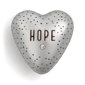 Silver heart figurine with brown spots and'HOPE' in brown letters centered