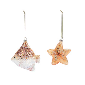 gold and white fish and starfish ornaments with glitter on top