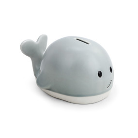gray ceramic whale bank with smiling face