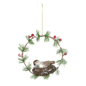 wreath ornament with bird and nest in middle