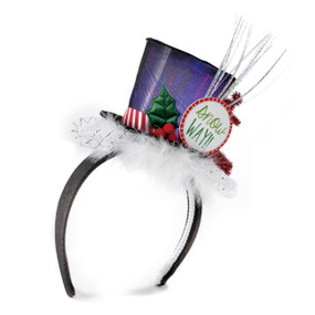 black headband with mini purple top hat and white fuzz with round sign reading Snow Way