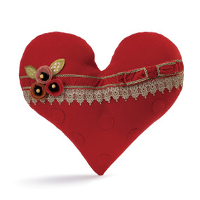 red stuffed heart with ribbon decorations