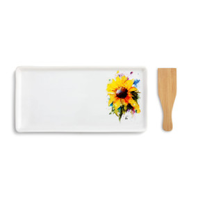 A white appetizer tray with a sunflower painted on the right side. Placed beside a wooden spatula.