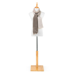 """A beige and brown """"Our Bond"""" scarf, draped as a shawl on a white and black metal mannequin."""
