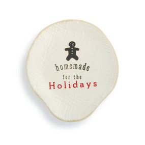 Cream ceramic spoon rest that says Homemade for the Holidays