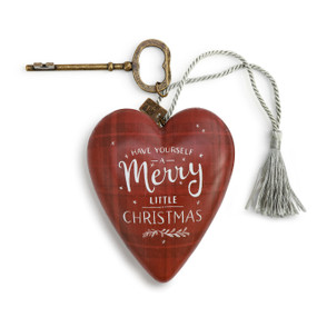 """A red plaid art heart with """"Have Yourself a Merry Little Christmas"""" in white font, a silver tassel, and a bronze key."""