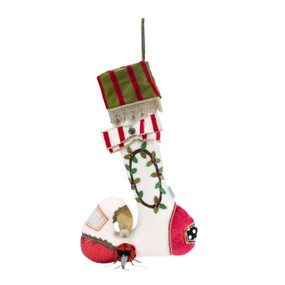 A white stocking with various red fabrics and a green wreath in the center.