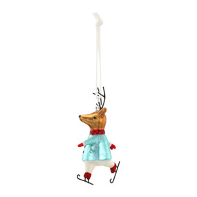 A hanging blown glass ornament shaped like an ice skating reindeer