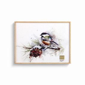 Wood framed wall art of a chickadee on a snowy branch with a pinecone