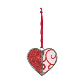 Red heart glass ornament with one half all red and the other half red swirl on a red hanging ribbon