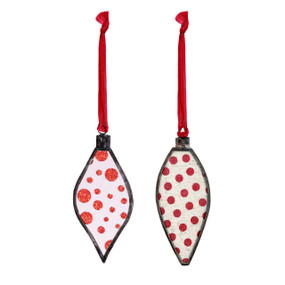 Two metal and glass bulb ornaments with red polka dots.