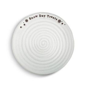 """A white swirled snack plate with black snowflakes and reads """"Snow Day Treats"""" in a black font."""
