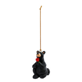 Black bear ornament on bended knee holding a rose in proposal