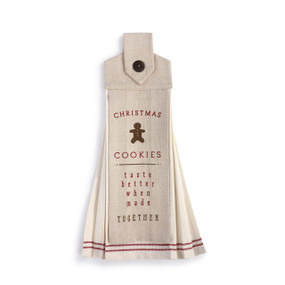 """An ivory """"Button Loop Tea Towel"""" with red accents and a Christmas cookies message."""