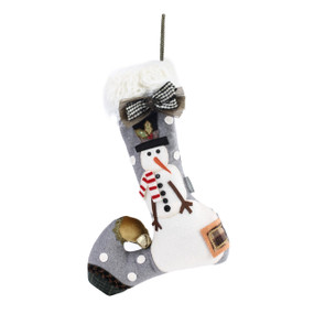 A gray stocking with a large snowman and white polka dots.